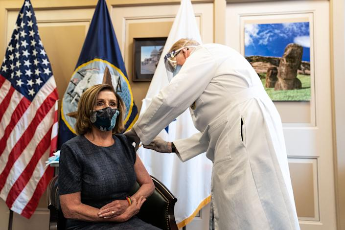 Brian Monahan, the Attending Physician of the United States Congress, administers the Pfizer-BioNTech COVID-19 vaccine to House Speaker Nancy Pelosi, D-Calif.,in the U.S. Capitol Building on Dec. 18, 2020 in Washington.