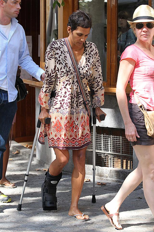 A make up-free Halle Berry looked to be in pain as she walked around with crutches after breaking her foot. The actress was seen having lunch with her daughter and friends at a local restaurant. Her daughter was treated to a large ice cream cone and was seen looking after her mother as they crossed the road. Halle reportedly broke her foot at her Spanish rented villa after a day off from filming her new film, 'Cloud Atlas', which co-stars Tom Hanks. 