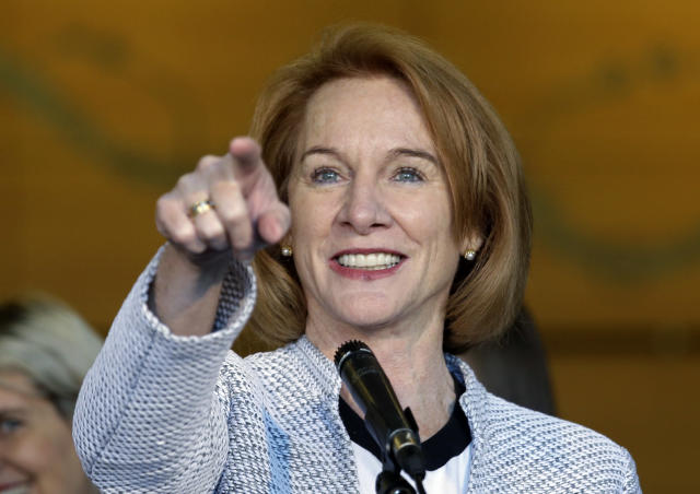 FILE - In this Dec. 6, 2017, file photo, Seattle Mayor Jenny Durkan acknowledges a reporter while taking questions before signing an agreement to renovate KeyArena in Seattle. Seattle is almost on the goal line in its pursuit of an NHL team thanks to an ownership group featuring Jerry Bruckheimer, a successful deal to renovate downtown KeyArena and fervent interest from fans that led to 10,000 season tickets selling out in 12 minutes and 32,000 total deposits being secured. (AP Photo/Elaine Thompson, File)