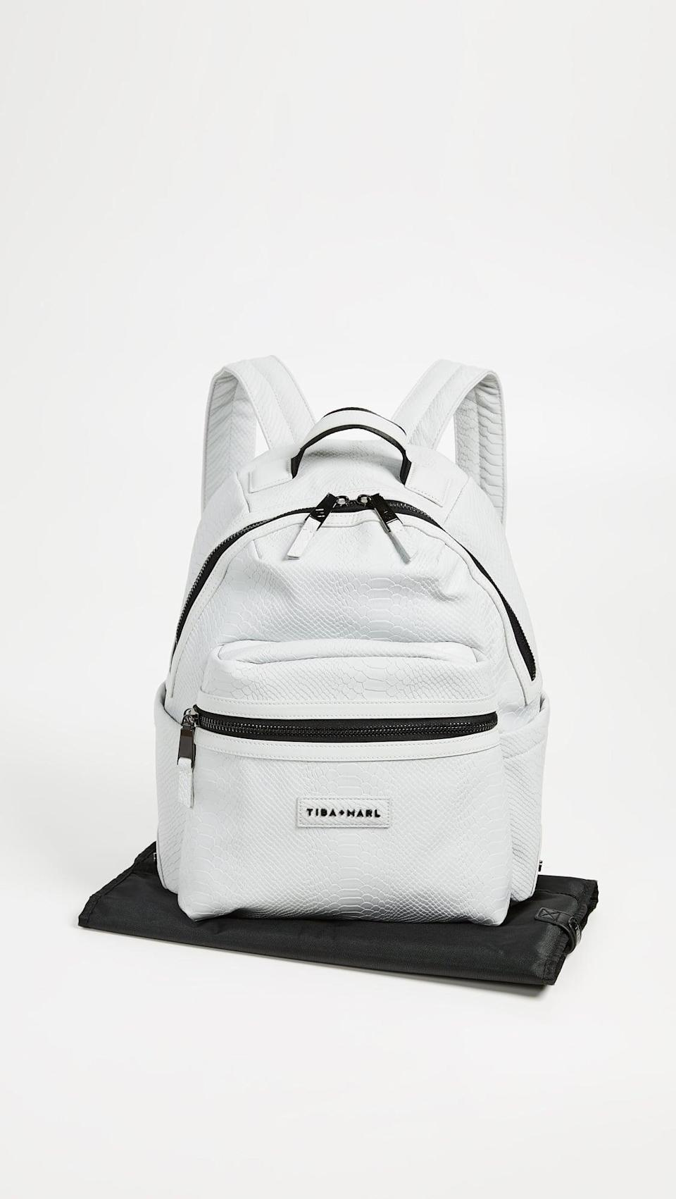 <p>The <span>Tiba + Marl Miller Diaper Backpack</span> ($225) has a small pouch that you can carry as its own crossbody.</p>