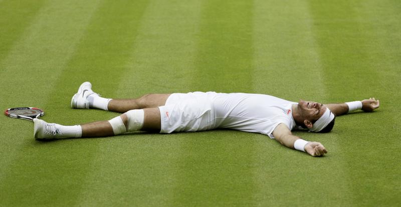 Juan Martin Del Potro of Argentina reacts after defeating David Ferrer of Spain in their Men's singles quarterfinal match at the All England Lawn Tennis Championships in Wimbledon, London, Wednesday, July 3, 2013. (AP Photo/Alastair Grant)