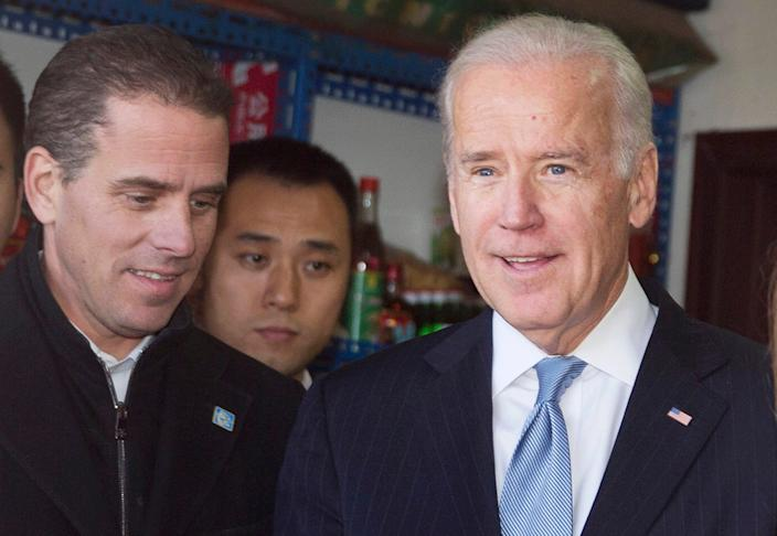 Then US Vice President Joe Biden (R) tours a Hutong alley with his son Hunter Biden (L) in Beijing, China, 05 December 2013.