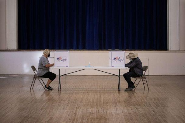 PHOTO: In this Nov. 3, 2020, file photo, local residents Cynthia Daugherty and Eugene Binder vote in the 2020 presidential election in Marfa, Texas. (Adrees Latif/Reuters, FILE)