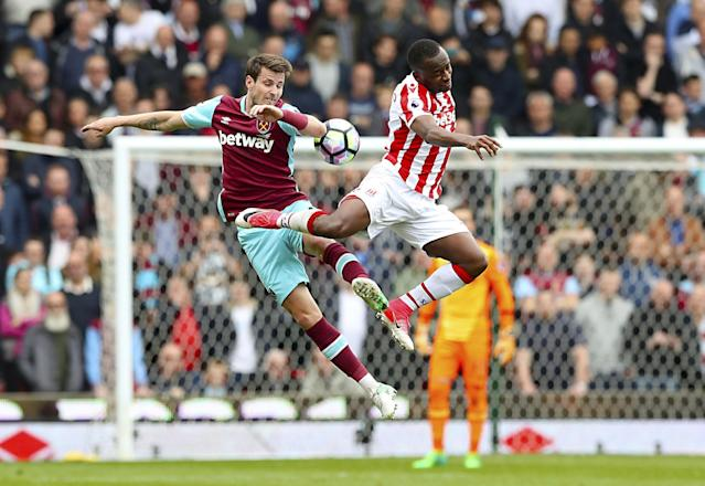 <p>West Ham United's Havard Nordtveit, left, and Stoke City's Saido Berahino battle for the ball </p>