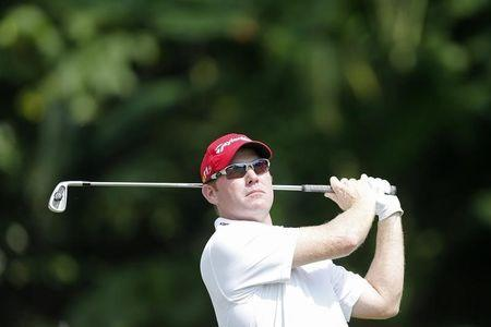 Troy Matteson of the U.S. tees off on the first hole during the third round of the Malaysia's Asia Pacific Classic golf tournament in Kuala Lumpur October 27, 2012. REUTERS/Bazuki Muhammad