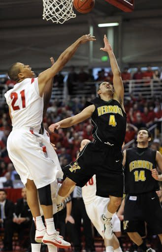 Vermont's Four McGlynn (4) shoots over Stony Brook's Al Rapier (21) during the second half of the America East Conference tournament championship NCAA college basketball game on Saturday, March 10, 2012, in Stony Brook, NY. Vermont won 51-43. (AP Photo/Kathy Kmonicek)