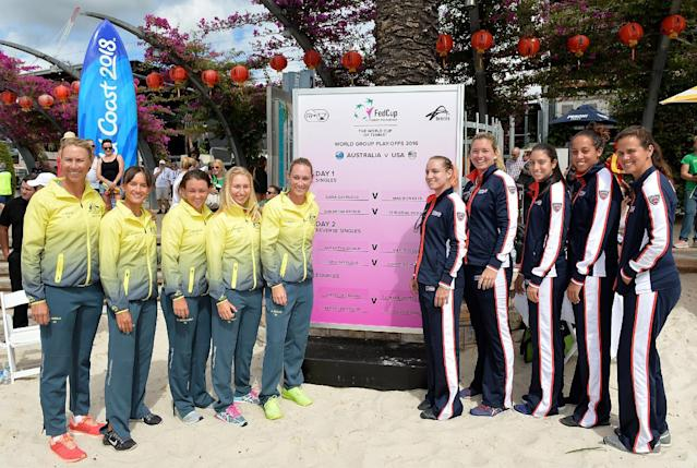 BRISBANE, AUSTRALIA - APRIL 15: (L-R) Alicia Molik, Arina Rodionova, Casey Dellacqua, Daria Gavlirova, Samantha Stosur, Bethanie Mattek-Sands, Coco Vandeweghe, Christina McHale, Madison Keys and Mary Joe Fernandez pose for a photo during the official draw for the Fed Cup tie between Australia and the United State at Pat Rafter Arena on April 15, 2016 in Brisbane, Australia. (Photo by Bradley Kanaris/Getty Images)