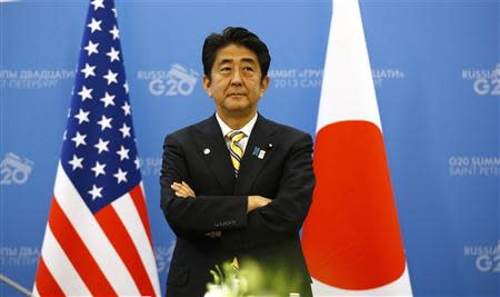 Japanese Prime Minister Shinzo Abe waits for U.S. President Barack Obama to arrive for their meeting at the G20 Summit in St. Petersburg September 5, 2013. REUTERS/Kevin Lamarque