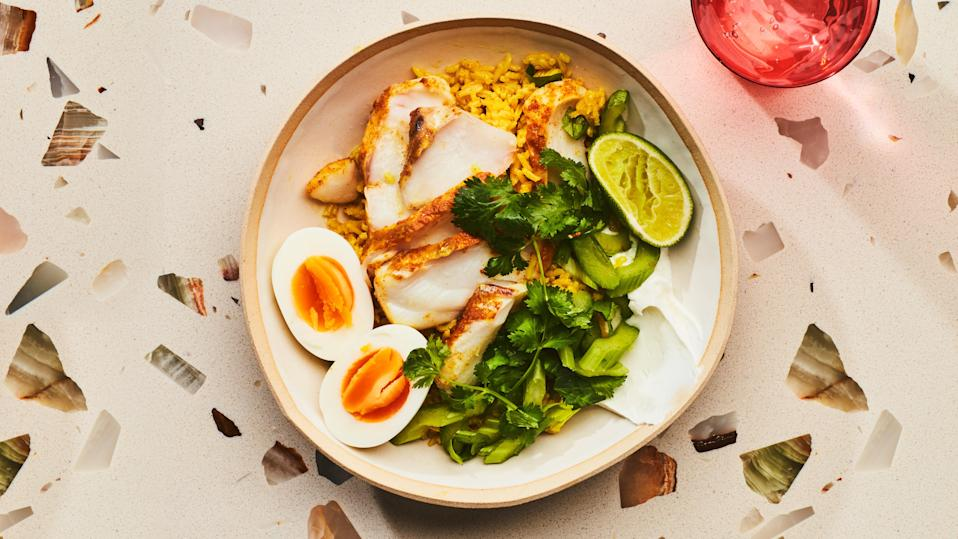 "Kedgeree, a traditional Anglo-Indian recipe, often calls for smoked fish, but for a light weeknight meal, we prefer steaming fresh fish right on top of the rice. <a href=""https://www.bonappetit.com/recipe/rice-bowls-with-flaky-cod?mbid=synd_yahoo_rss"" rel=""nofollow noopener"" target=""_blank"" data-ylk=""slk:See recipe."" class=""link rapid-noclick-resp"">See recipe.</a>"