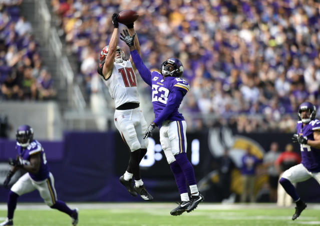<p>Adam Humphries #10 of the Tampa Bay Buccaneers catches the ball over defender Terence Newman #23 of the Minnesota Vikings in the second half of the game on September 24, 2017 at U.S. Bank Stadium in Minneapolis, Minnesota. (Photo by Hannah Foslien/Getty Images) </p>