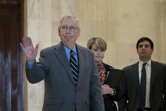 Senate Majority Leader Mitch McConnell, R-Ky., exits a Senate GOP lunch meeting in Washington, D.C., on Friday.