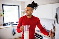 """<p>Guys who drink dairy may want to incorporate milk into their snacks. Milk is a good source of carbohydrates, fat, and protein—which can minimize hunger, says Boehmer. </p><p>An eight-ounce serving of 2 percent milk contains roughly <a href=""""https://www.menshealth.com/nutrition/a19528088/2-percent-milk-nutrition-facts/"""" rel=""""nofollow noopener"""" target=""""_blank"""" data-ylk=""""slk:122 calories and 8 grams of protein."""" class=""""link rapid-noclick-resp"""">122 calories and 8 grams of protein.</a> However, Boehmer recommends including actual food with your protein-packed drinks since that increases satiety. </p>"""
