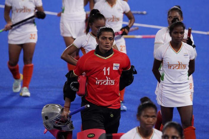 India goalkeeper Savita (11) and her teammates walk off the field after losing their women's field hockey semi-final match against Argentina at the 2020 Summer Olympics, Wednesday, Aug. 4, 2021, in Tokyo, Japan. (AP Photo/John Locher)