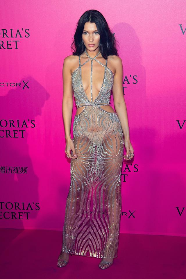<p>The 20-year-old wore a see-through Swarovski crystal cutout gown to the afterparty after walking in her first Victoria's Secret Fashion Show. (Photo: Getty Images) </p>