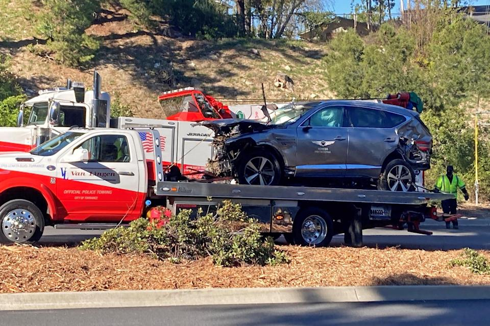 The vehicle driven by Tiger Woods on the back of a truck in Los Angeles after he suffered leg injuries when the vehicle rolled over.PA