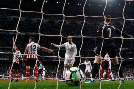 Soccer Football - La Liga Santander - Real Madrid vs Athletic Bilbao - Santiago Bernabeu, Madrid, Spain - April 18, 2018 Real Madrid's Cristiano Ronaldo scores their first goal REUTERS/Susana Vera