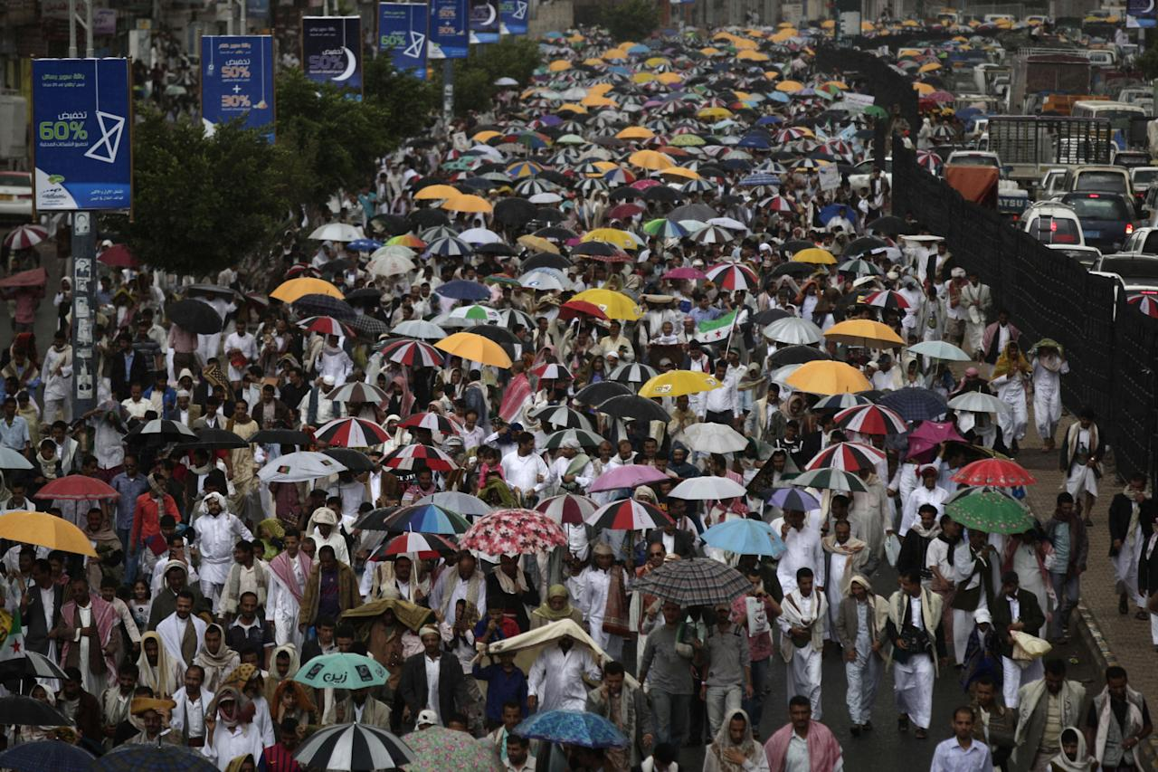 Protestors march during a demonstration demanding that the relatives of former President Ali Abdullah Saleh be fired from army and police posts in Sanaa, Yemen, Friday, July 27, 2012. (AP Photo/Hani Mohammed)