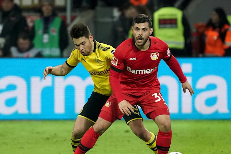 LEVERKUSEN, GERMANY - FEBRUARY 08: (BILD ZEITUNG OUT) Raphael Guerreiro of Borussia Dortmund and Kevin Volland of Bayer 04 Leverkusen during the Bundesliga match between Bayer 04 Leverkusen and Borussia Dortmund at BayArena on February 8, 2020 in Leverkusen, Germany. (Photo by TF-Images/Getty Images)