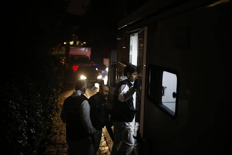 Turkish forensic officers arrive at the Saudi consulate to conduct a new search over the disappearance and alleged slaying of writer Jamal Khashoggi, in Istanbul, early Thursday. (AP)