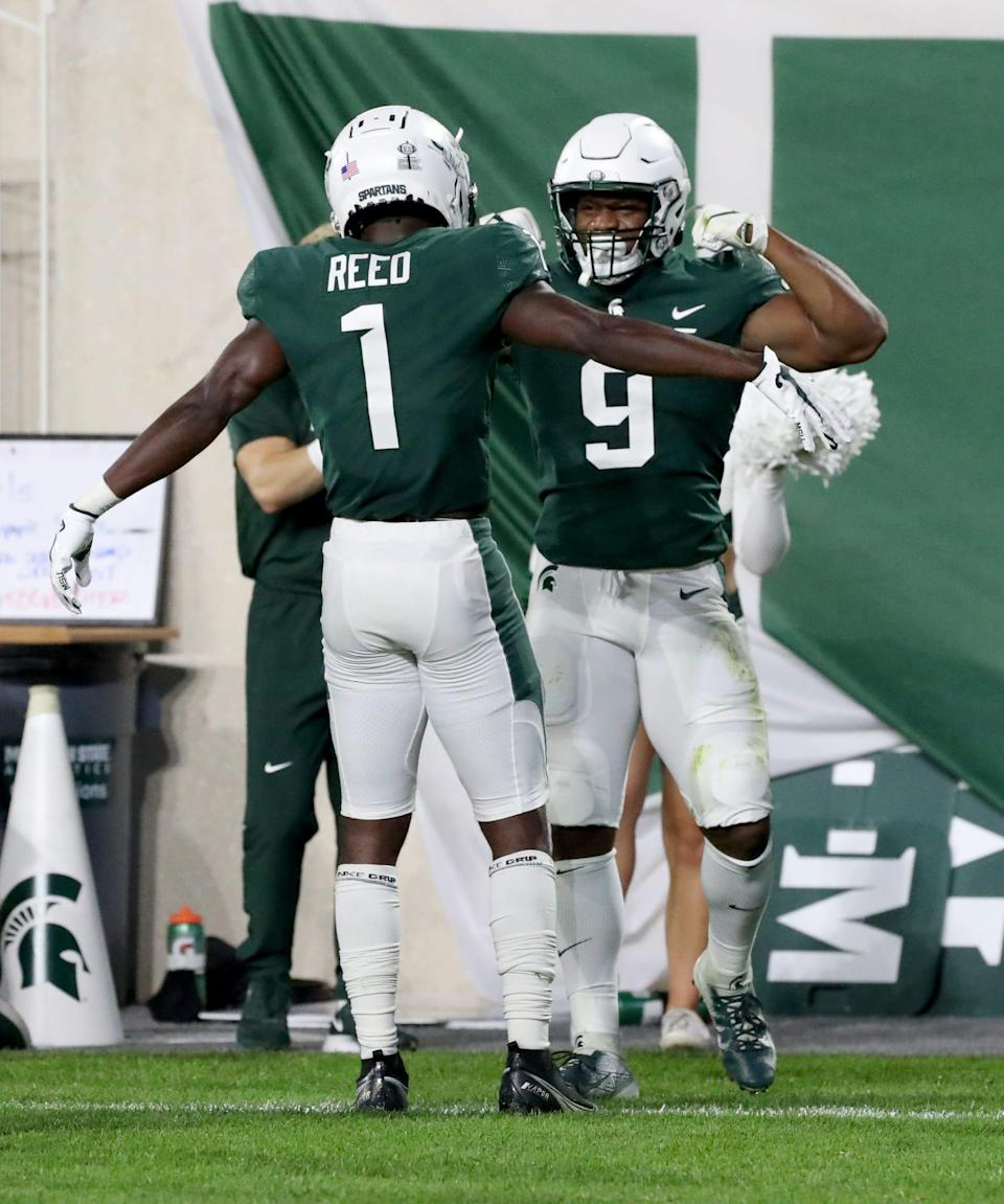 Michigan State Spartans wide receiver Jayden Reed (1) and running back Kenneth Walker III (9) celebrate after a touchdown against the Western Kentucky Hilltoppers Saturday, Oct. 02, 2021.