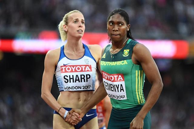 South Africa's Caster Semenya (R) shakes hands with Britain's Lynsey Sharp after the semi-final of the women's 800m athletics event at the 2017 IAAF World Championships at the London Stadium in London on August 11, 2017 (AFP Photo/Jewel SAMAD)