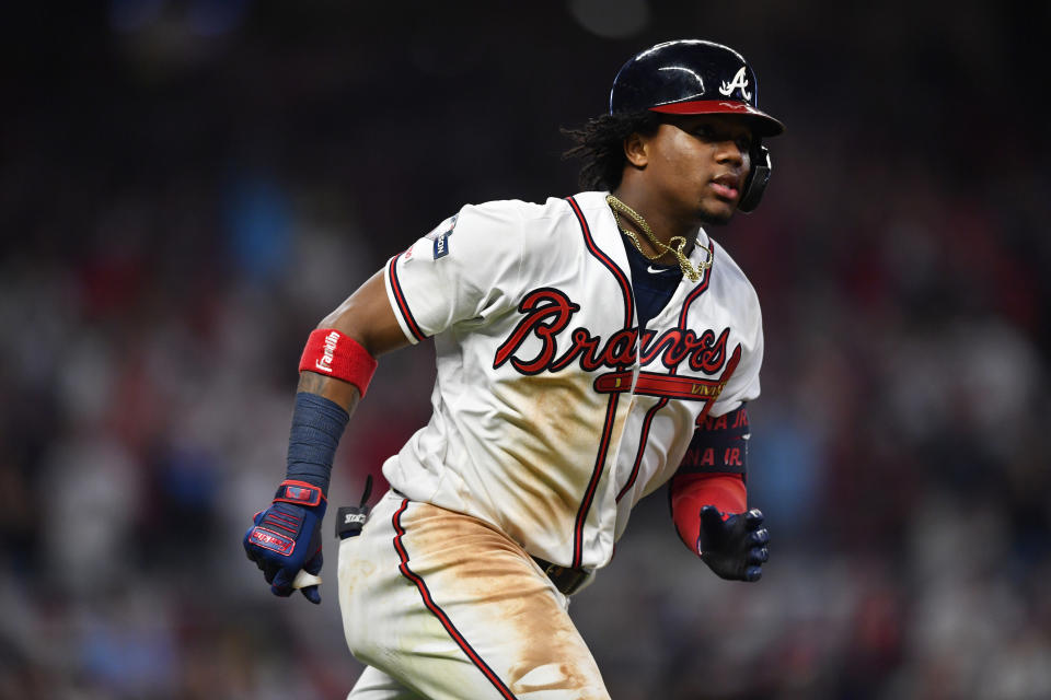 Atlanta Braves center fielder Ronald Acuna Jr. (13) runs to first base after a hit against the St. Louis Cardinals in the seventh inning during Game 1 of a best-of-five National League Division Series, Thursday, Oct. 3, 2019, in Atlanta. (AP Photo/John Amis)