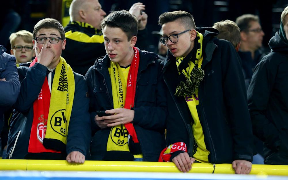 Fans of Dortmund are concerned of the bomb attack to the bus of Borussia Dortmund prior to the UEFA Champions League Quarter Final first leg match between Borussia Dortmund and AS Monaco at Signal Iduna Park - Credit: Getty