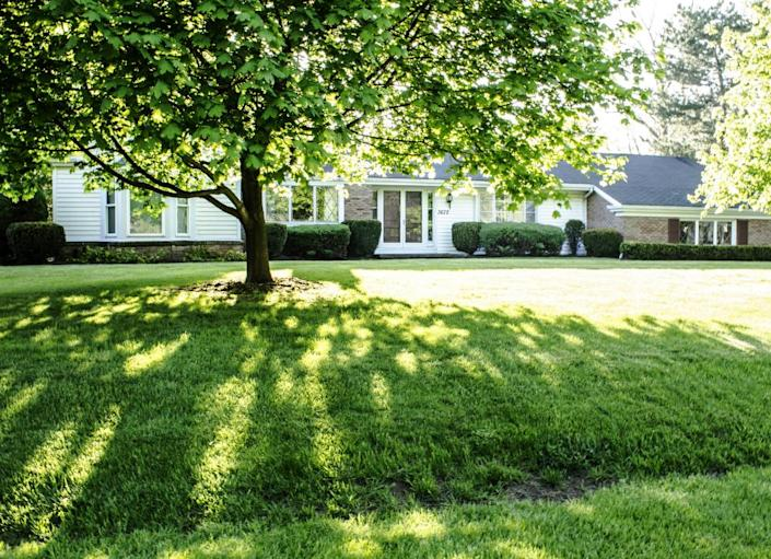 """<body> <p>A peaceful tree-lined street is a beautiful thing—but trying to grow grass in all that shade? Not so much. Even so-called """"shade-tolerant"""" grass varieties are difficult to grow under trees or near shaded foundations. That's never a problem with artificial turf. Not only can you install this """"<a rel=""""nofollow noopener"""" href="""" http://www.bobvila.com/articles/grass-alternatives/#.VW9riM9ViT4?bv=yahoo"""" target=""""_blank"""" data-ylk=""""slk:lawn"""" class=""""link rapid-noclick-resp"""">lawn</a>"""" in shady corners of your yard, but it also works in nontraditional areas, such as rocky slopes or sandy soil.</p> <p><strong>Related: <a rel=""""nofollow noopener"""" href="""" http://www.bobvila.com/slideshow/10-plants-for-where-the-sun-don-t-shine-44559#.VW9r789ViT4?bv=yahoo"""" target=""""_blank"""" data-ylk=""""slk:10 Plants for Where the Sun Don't Shine"""" class=""""link rapid-noclick-resp"""">10 Plants for Where the Sun Don't Shine</a> </strong> </p> </body>"""