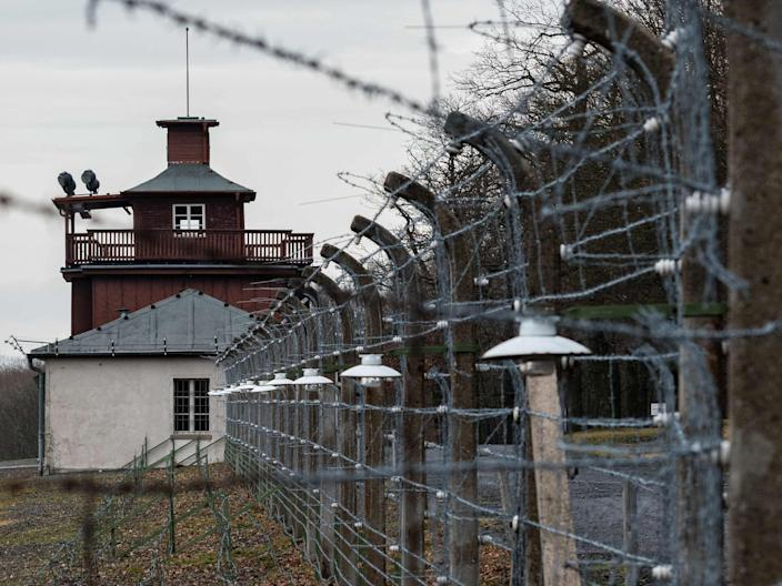 A barbed wire fence encloses the memorial site of the former Nazi concentration camp Buchenwald near Weimar, eastern Germany, on January 27, 2020. - A ceremony took place at the site to mark the International Holocaust Remembrance Day, 75 years after the liberation of the Auschwitz death camp in then occupied Poland. (Photo by JENS SCHLUETER / AFP) (Photo by JENS SCHLUETER/AFP via Getty Images)