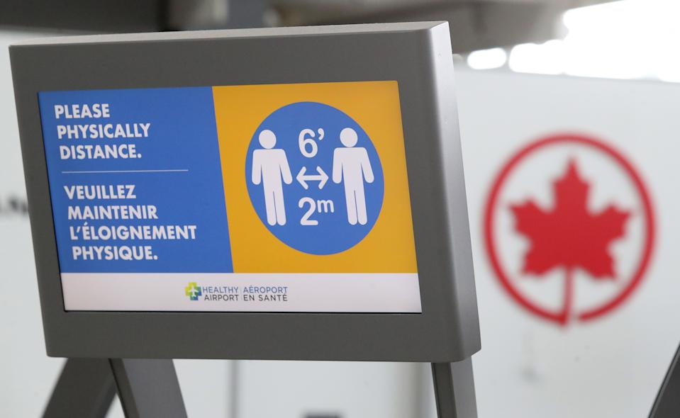 TORONTO, ON- JULY 30  -  Passengers are temperature screened at the departure gates at Pearson International Airport. Toronto will move into phase three of reopening  with other parts of Ontario later in the week as the province tries to slow the spread of COVID-19  in Toronto. July 30, 2020.        (Steve Russell/Toronto Star via Getty Images)