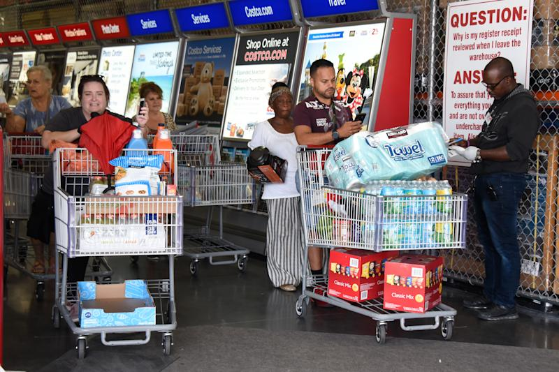 Miami, Florida, residents stock up on groceries at a Costco on Aug. 29, 2019, as they prepare for Hurricane Dorian. (Photo: Michele Eve Sandberg/AFP/Getty Images)