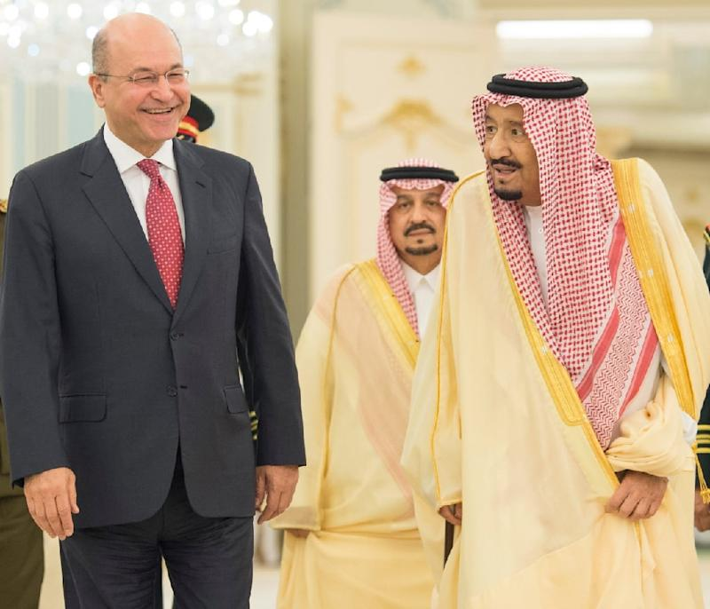 A handout photograph released by the Iraqi president's office on November 18, 2018 shows President Barham Saleh being received by Saudi Arabia's King Salman in the Saudi Red Sea coastal city of Jeddah