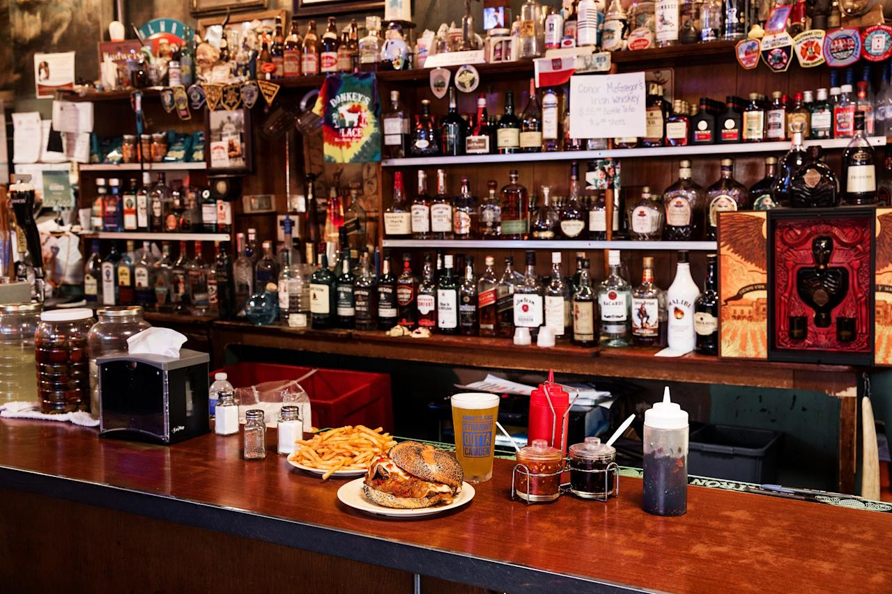 """<p><strong>Where is this place, again?</strong><br> I know you're looking for a <em>Philly</em> cheesesteak, but I need you to go across the bridge into Jersey for this one. Just trust me. Because inside this small, unpretentious bar decorated with boxing photos and various tchotchkes is one of the best cheesesteaks in the whole damn country. It was even blessed by the late, great <a href=""""https://www.cntraveler.com/story/remembering-anthony-bourdain?mbid=synd_yahoo_rss"""">Anthony Bourdain</a>.</p> <p><strong>What's the crowd like?</strong><br> Donkey's is only open between noon and 6:00 p.m. on weekdays, and if you happen to go during the lunch rush (like we did), expect to find the place packed. While there were obviously a few newbies around, lured by the popularity of Donkey's cheesesteaks, most of the customers seemed to be regulars on their lunch breaks.</p> <p><strong>What should we be drinking?</strong><br> Despite only being open in the afternoon, Donkey's has a full bar and a short, but well-rounded list of quality drafts. When we dropped in, the tap list included Stone Brewing, Evil Genius Beer Company, and Victory Brewing Company.</p> <p><strong>Tell us about the food.</strong><br> Prepare yourself: Donkey's cheesesteaks do not conform to the image you undoubtedly have of the classic sandwich. Instead, the meat (piled high and so incredibly seasoned you could eat a plate of it, unadorned) is packed into a poppyseed Kaiser roll and topped with onions and American cheese. Think this sounds blasphemous? Take a bite and then come talk to us about how a cheesesteak is """"supposed"""" to look.</p> <p><strong>Was the service decent?</strong><br> Cheesesteak shops aren't exactly known for their congeniality; but the servers at Donkey's make you feel like a regular, even if it's your first time there. It's like they're single-handedly trying to buck the cheesesteak's intimidating reputation.</p> <p><strong>At the end of the day, why are we schlepping across the bridge?<"""
