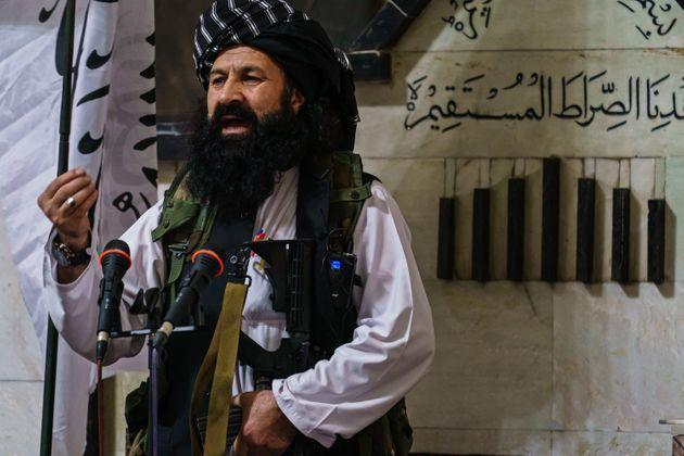 Khalil al-Rahman Haqqani, a leader of the Taliban affiliated Haqqani network, and a U.S.-designated terrorist with a five million dollar bounty, deliver his sermon to a large congregation at the Pul-I-Khishti Mosque in Kabul, Afghanistan, Friday, Aug. 20, 2021 (Photo: Marcus Yam via Getty Images)