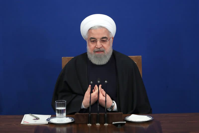 Iranian President Hassan Rouhani speaks during a news conference in Tehran