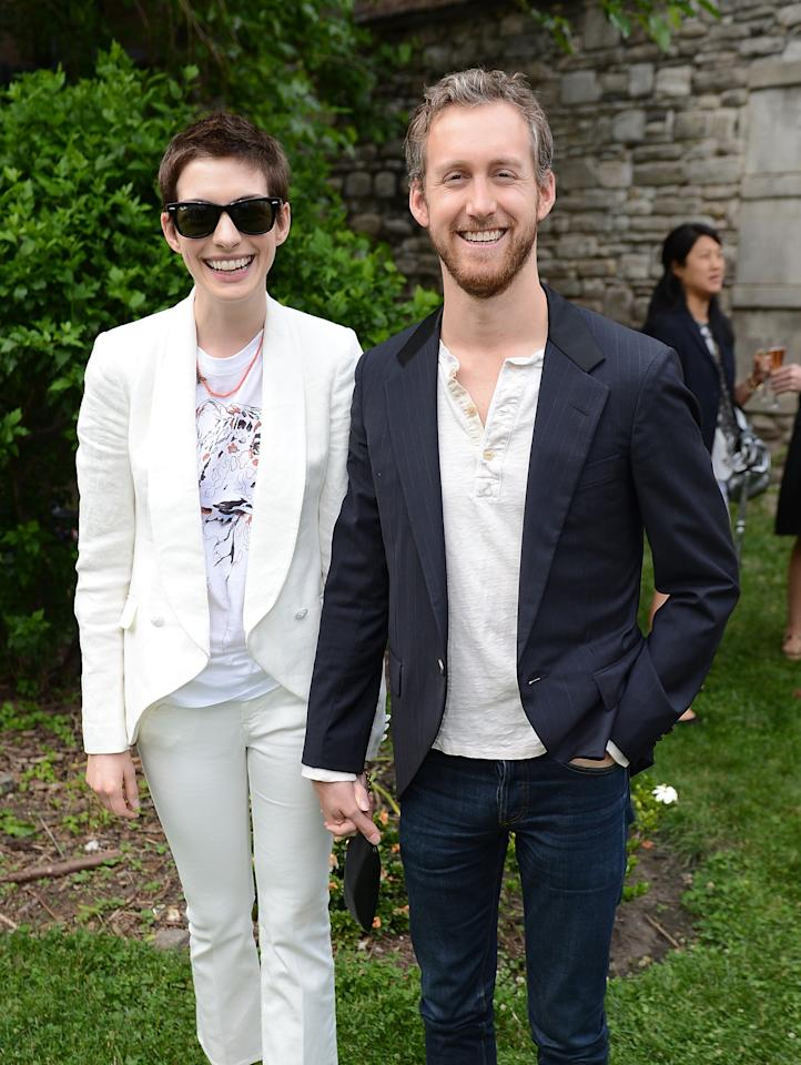 NEW YORK, NY - JUNE 11:  Actors Anne Hathaway and Adam Shulman attend the Stella McCartney Spring 2012 Presentation on June 11, 2012 in New York City.  (Photo by Andrew H. Walker/Getty Images)