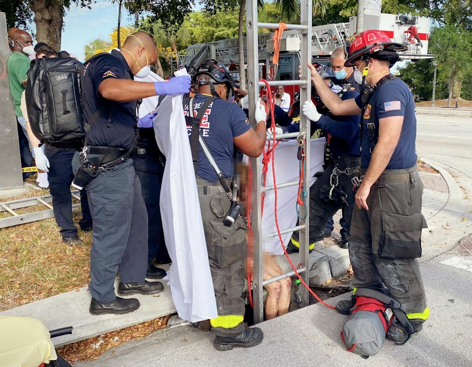 Naked woman rescued from drain.