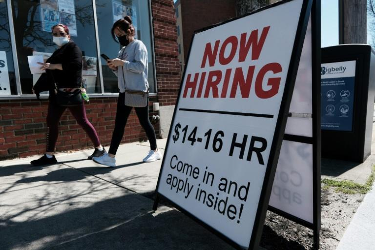 A company advertises a help wanted sign in Pawtucket, Rhode Island in April