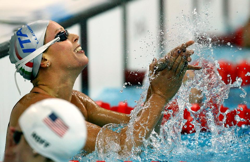 BEIJING - AUGUST 11: Federica Pellegrini of Italy celebrates finishing the Women's 200m Freestyle Heat 6 in first place held at the National Aquatics Center on Day 3 of the Beijing 2008 Olympic Games on August 11, 2008 in Beijing, China. Federica Pellegrini of Italy finished the race in a time of 1.55.45 a new World Record. (Photo by Adam Pretty/Getty Images)