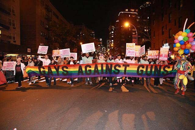 <p>Gays Against Guns carry a banner while marching in the 44th annual Village Halloween Parade in New York City on Oct. 31, 2017. (Photo: Gordon Donovan/Yahoo News) </p>