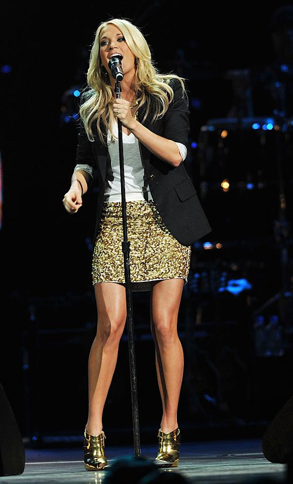 "Carrie Underwood kicked off the concert wearing a gold mini and metallic platform heels. The country cutie sang ""Undo It"" and ""Jesus, Take the Wheel/How Great Thou Art."" Fred Breedon/Nashville Rising/<a href=""http://www.gettyimages.com/"" target=""new"">GettyImages.com</a> - June 22, 2010"