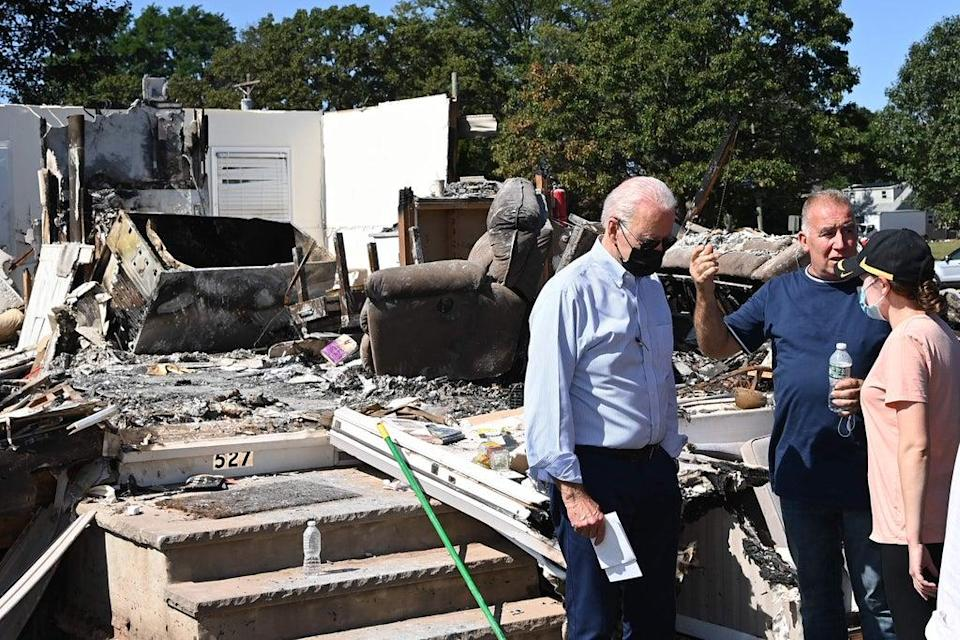 Joe Biden tours a neighbourhood in New Jersey on 7 September impacted by the remants of Hurricane Ida. (AFP via Getty Images)