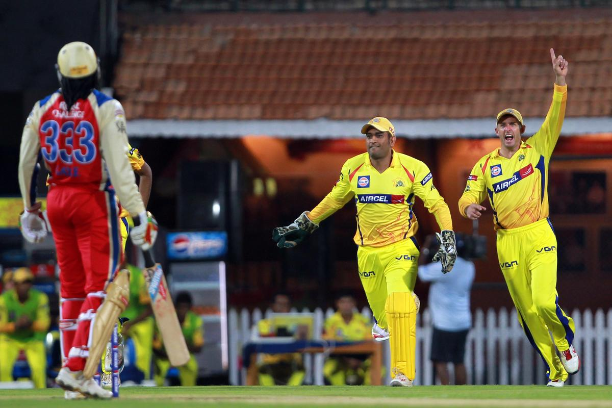 MS Dhoni and Michael Hussey celebrate the wicket of Chris Gayle during match 16 of the Pepsi Indian Premier League between The Chennai Superkings and the Royal Challengers Bangalore held at the MA Chidambaram Stadiumin Chennai on the 13th April 2013. Photo by Jacques Rossouw-IPL-SPORTZPICS   .. .Use of this image is subject to the terms and conditions as outlined by the BCCI. These terms can be found by following this link:..https://ec.yimg.com/ec?url=http%3a%2f%2fwww.sportzpics.co.za%2fimage%2fI0000SoRagM2cIEc&t=1503433926&sig=wAUc0Y8tR4MUzVFzmPv4qA--~D