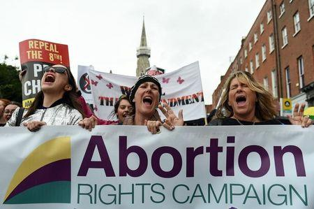FILE PHOTO: Demonstrators take part in a protest to urge the Irish Government to repeal the 8th amendment to the constitution, which enforces strict limitations to a woman's right to an abortion, in Dublin