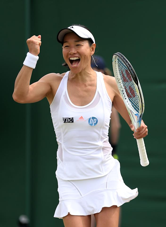 LONDON, ENGLAND - JUNE 27: Kimiko Date-Krumm of Japan celebrates match point during the Ladies' Singles second round match against Alexandra Cadantu of Romania on day four of the Wimbledon Lawn Tennis Championships at the All England Lawn Tennis and Croquet Club on June 27, 2013 in London, England. (Photo by Clive Brunskill/Getty Images)