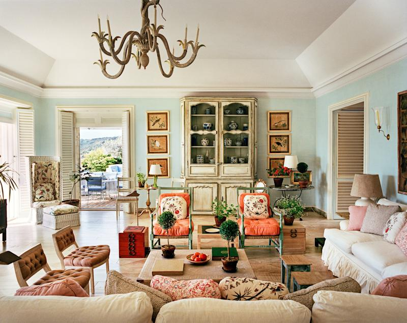 In the sitting room, Burch mixed in antique French finds with Bonacina wicker pieces.