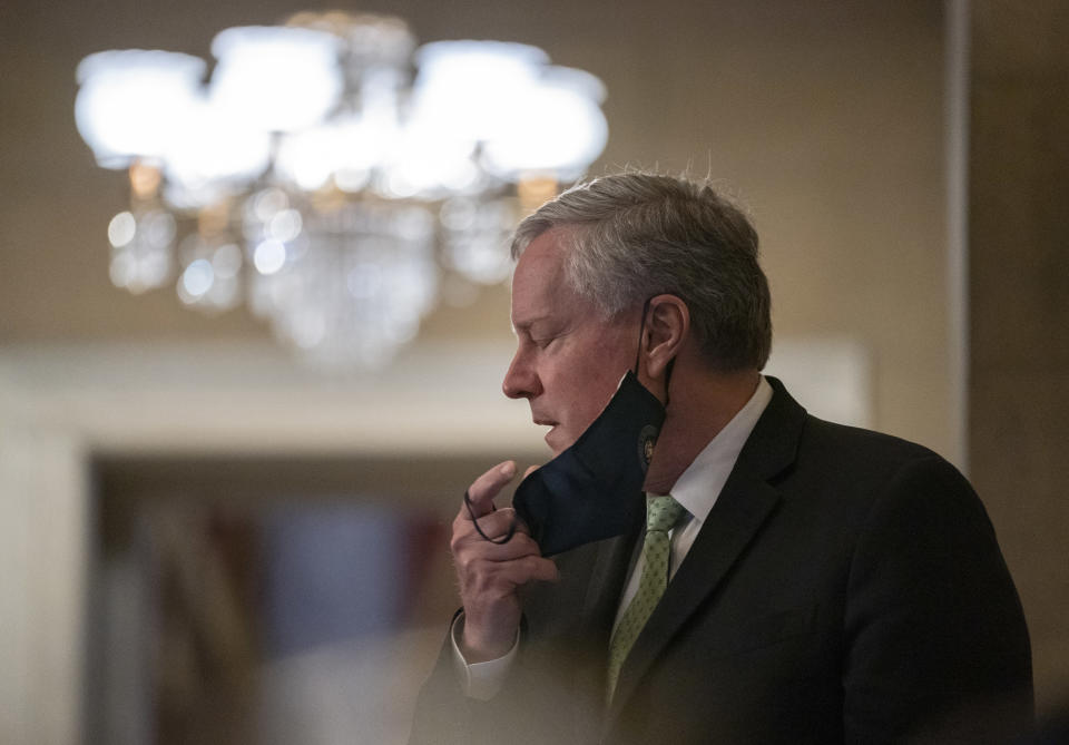 White House chief of staff Mark Meadows, removes his face mask to speak to media as he arrives at House Speaker Nancy Pelosi's office on Capitol Hill in Washington, Thursday, Aug. 6, 2020. (AP Photo/Carolyn Kaster)