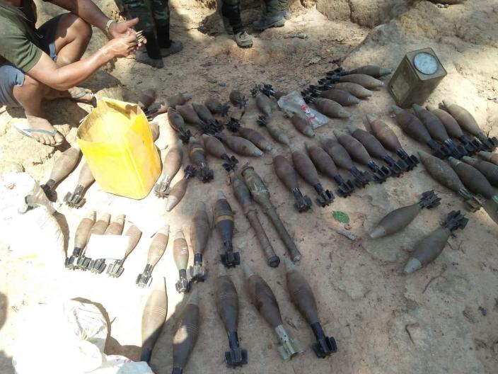 In this photo provided by Karen National Liberation Army, a cache of mortar shells are gathered together on the ground of a Myanmar military outpost Friday, May 7, 2021, in Mutraw district, Karen State, Myanmar. Ethnic Karen guerrillas burned down a Myanmar military outpost Friday morning, capturing it without a fight after its garrison fled at their approach, a senior Karen officer said. (Karen National Liberation Army via AP)