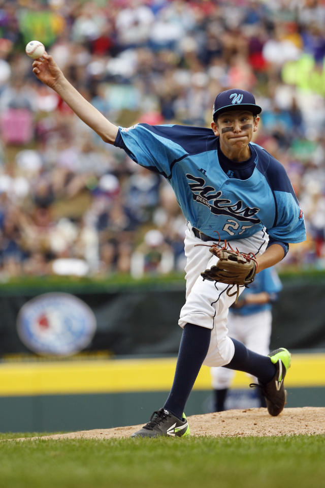Las Vegas' Brennan Holligan pitches during the first inning of the United States Championship baseball game against Chicago at the Little League World Series, Saturday, Aug. 23, 2014, in South Williamsport, Pa. Chicago won 7-5. (AP Photo/Matt Slocum)