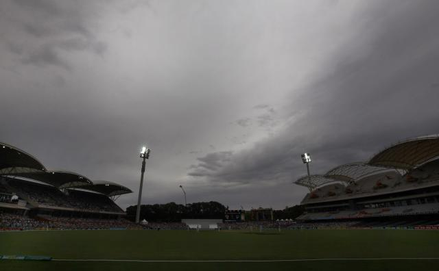 Storm clouds gather above the stadium during the fourth day's play in the second Ashes cricket test between England and Australia at the Adelaide Oval December 8, 2013. REUTERS/David Gray (AUSTRALIA - Tags: SPORT CRICKET)